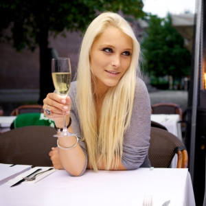 Beautiful lesbian woman drinking champagne