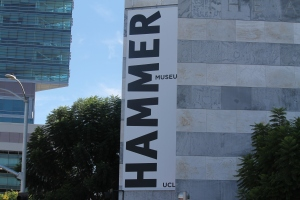 Huge banner on one side of building of the Hammer Museum.